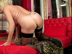 Busty mature Amy Goodhead in stockings loves playing on the bed