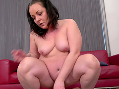 Older wife in black lingerie gives a blowjob and rides his shaft