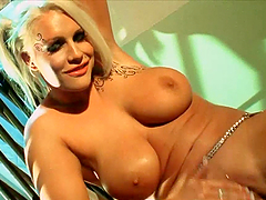 Busty Blonde Plays With Her Shaved Pussy