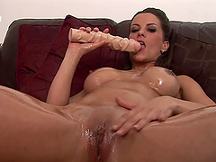 Kinky Brunette Masturbates With A Huge Dildo
