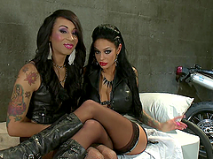 Brunette Biker Chick Getting Her Pussy Fucked by a Naughty Shemale