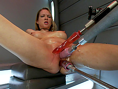 Blonde bombshell fucked by machine and dildo