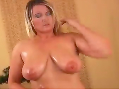 Busty Blonde Oils Herself Up And Masturbates