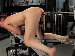Machine Drilling Makes A Sexy Redhead Reach An Orgasm