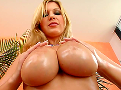 Busty Blonde Masturbates With A Large Cucumber