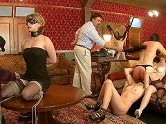Bondage Scene With Submissive Babes And Their Masters