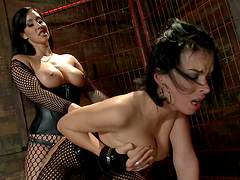 Hot brunette in fishnet fucked by dude & chick with strapon