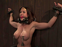 Big titty whore gagged and fixed to the wall