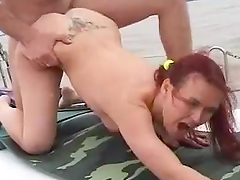 Redhead slut gets fucked on a yacht by some dude