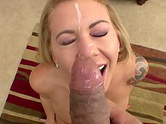 Smoking hot blonde sucks a big cock and gets a facial