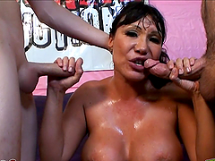 Busty skank gets semen-drenched!