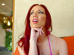 Busty redhead deep throats on a guy's large cock