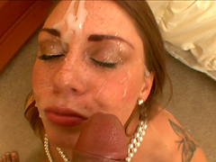 A messy facial for a slutty redhead sucking on a black cock