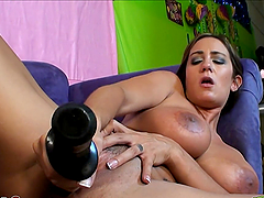 Busty babe titty fucks a big cock before sucking on it