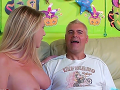 Busty blonde sucks on a big cock before masturbating