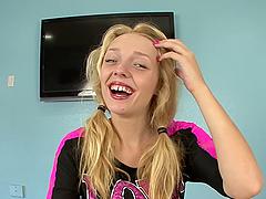 Slutty blonde teen deep throats a big cock