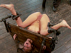 Blonde stuck in pillory can't avoid the toying orgasms in BDSM video