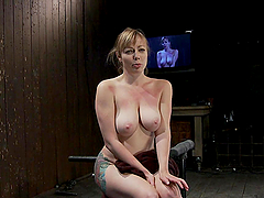 Bitch tied up and machine-fucked in bondage scene!
