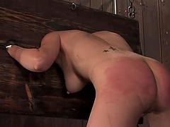 Skinny blonde bitch victim of bondage device!