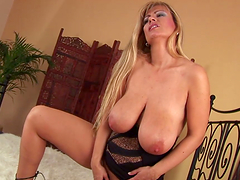 Huge titty whore licks her own nipples