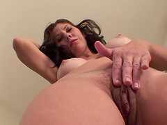 Brunette whore gets naked and fingers herself