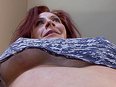 Busty redhead milf masturbates on a flight of stairs