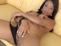 Ebony hottie penetrates her wet pussy with a dildo