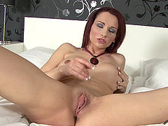 Redhead old cunt sticks hard toy in her gash