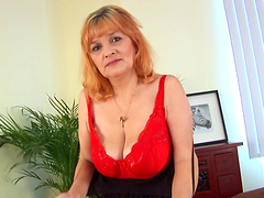 Old whore with big tits fingers her snatch