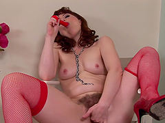 Mature bitch in red fucking fondles herself
