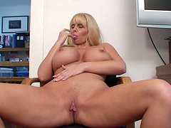 Blonde milf with huge tits fingers her cunt