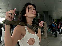 Beautiful brunette tied up and fucked in bondage scene