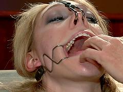 Bondage scene with blonde bitch