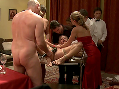 Blonde bitch fucked on top of a dinner table in BDSM scene