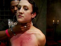 Kinky short-haired small-tit brunette in bondage scene