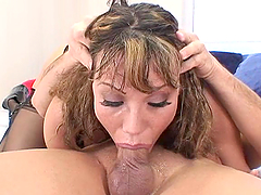 Horny milf takes a big cock down her slippery throat