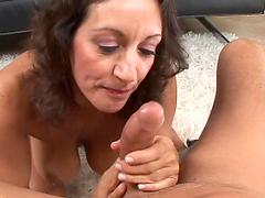 Busty mom titty fucks and sucks on a big cock