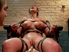 Big boobed brunette tortured with pleasure in lesbian BDSM
