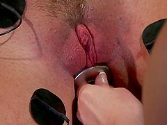 Brunette gets tortured with electricity in BDSM lesbian femdom video