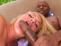 Horny blonde takes a ride on a black monster cock
