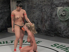 Brunette and blonde wrestle & fuck in the ring