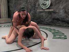 Brunettes wrestle naked & have strapon sex
