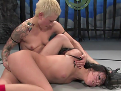 Strapon sex in the middle of the ring with sexy lesbians