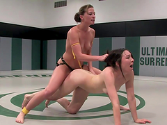 Horny bitches wrestle naked and have sex