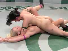 Slutty couple of chicks wrestle naked and have sex