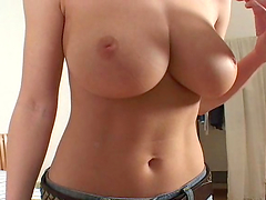Sexy brunette plays with her big tits and pussy