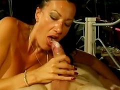 Slutty brunette sucks on a big fat cock