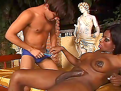 Dude sucks on a huge black tranny dick & gets nailed