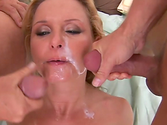 Blonde slut fucked by two dudes gets massive cum on her face