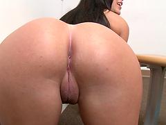 Beautiful brunette sucks a big cock through a gloryhole